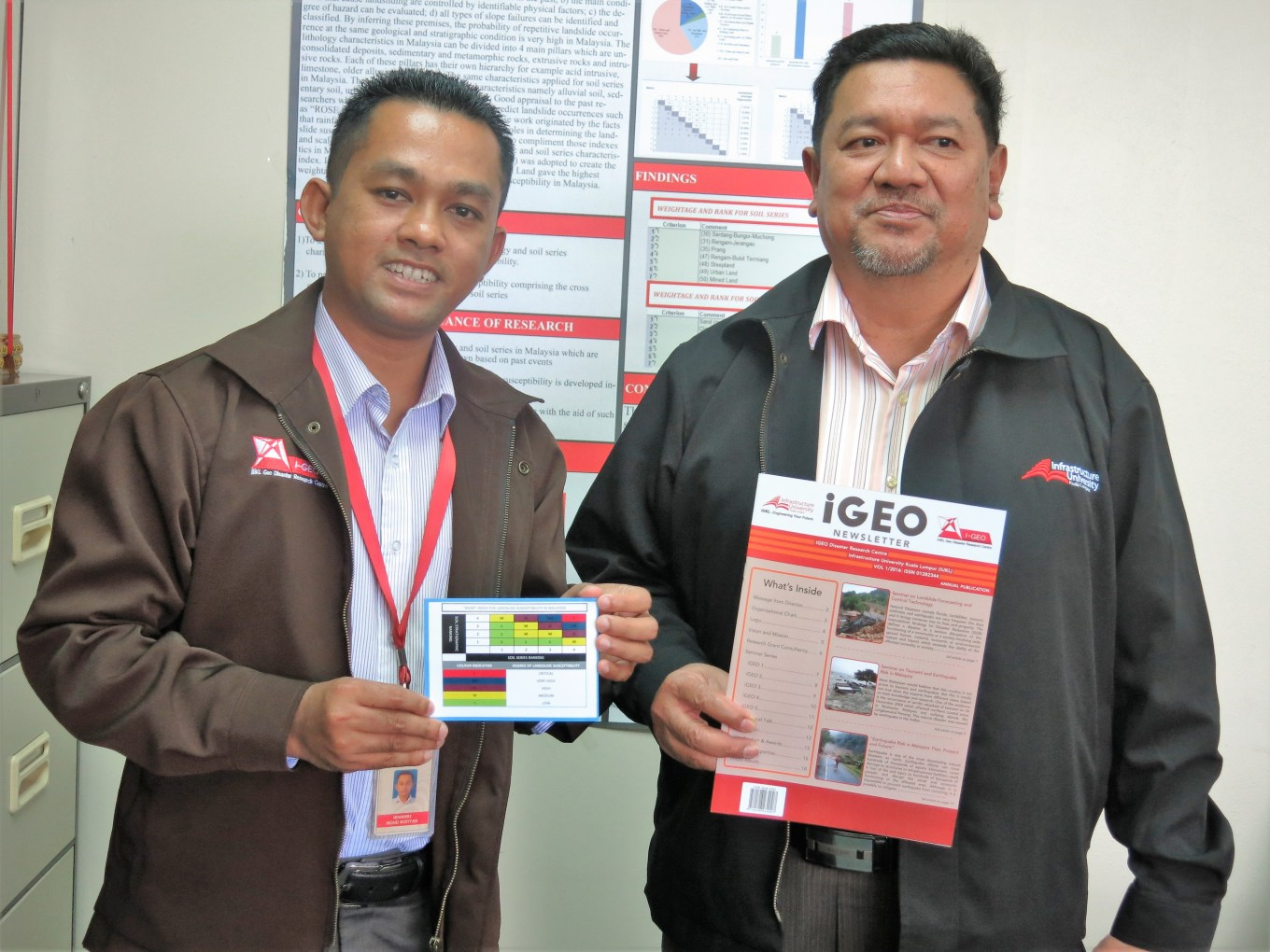 Prof. Dr. Roslan (right) and Head, I-Geo Disaster Research Centre, Dr. Mohd. Sofiyan Sulaiman showing a chart indicating soil stratigraphic ranking and degree of landslide susceptibility.