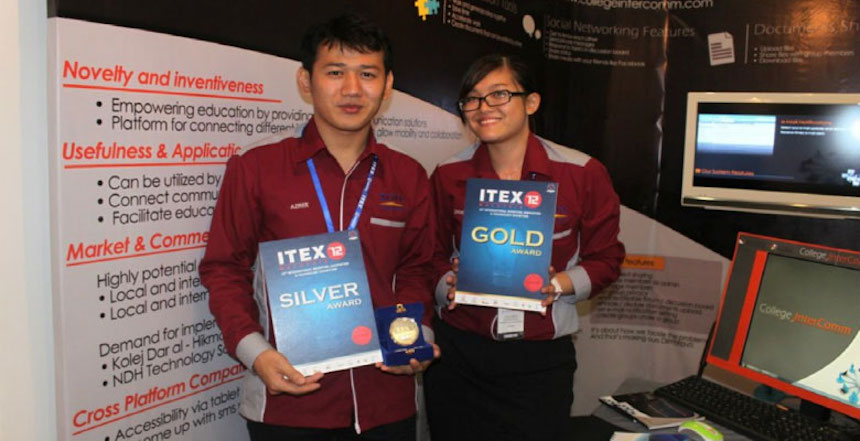 The winners showing off their medals at their exhibition booth at ITEX 2012