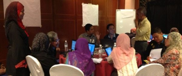 Participants and panel members deep in discussion at the research workshop, Avillion, Port Dickson, 2012
