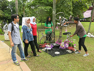 Students with their sculpture display at the Student Village.